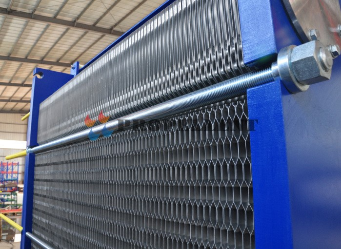 Low cost high efficiency Propellent plate heat exchanger for ethanol production industry